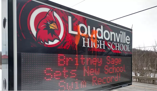 A Digital School Sign vandalized