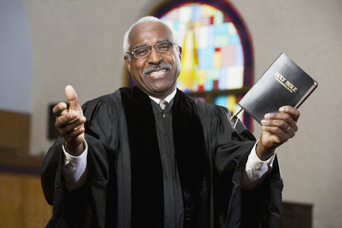 Black Preacher welcoming guests to Church