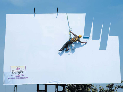 Clever Highway Billboard of man painting