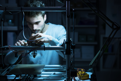 Man working with a 3d printer
