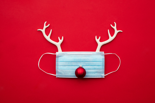 A covid mask with reindeer antlers for Christmas | Church Signs for Christmas