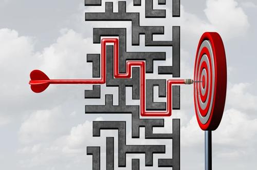 An arrow meandering through a maze to hit a bullseye