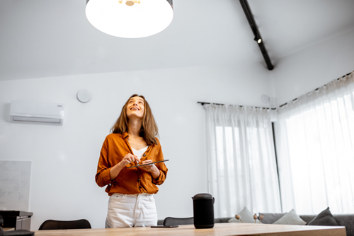 New LED Technology   Woman using a laptop for smart lighting in a room