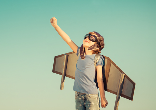 Kid with wings inspiring to reach for the stars