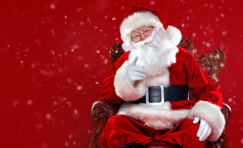 Santa sitting on a chair amidst a festive red background
