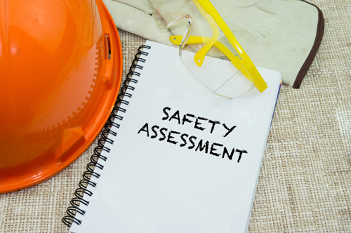 Safety Assessment Dossier with hard hat near it